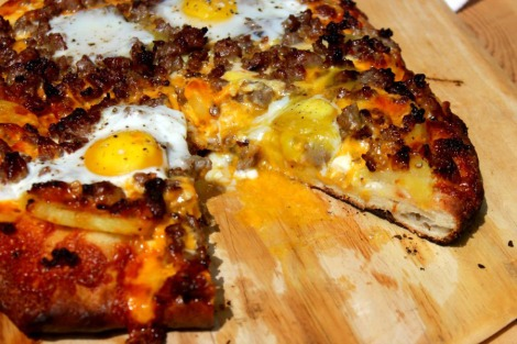 Breakfast pizza sliced